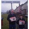 John Barnett, Candidate for Dundee West, with son Rory, campaigning in St Mary's