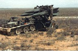 Soldiers with Missile Battery in Desert